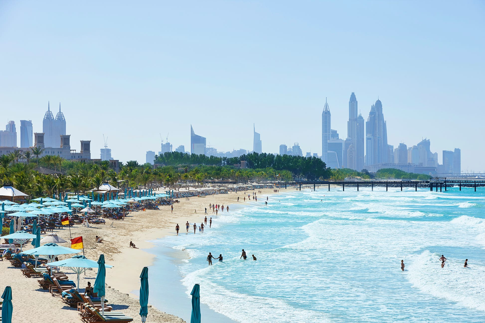 People in the water at Jumeirah Beach with the Dubai skyline in the distance ©R.A.R. de Bruijn Holding BV/Shutterstock
