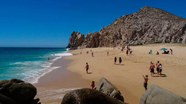 Tourists sunbathe at the 'Love Beach' in Los Cabos, Baja California Sur state, Mexico in March, 2018.