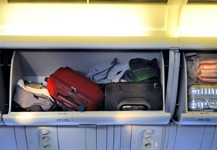 Italy bans the use of overhead bins on some flights © robert paul van beets/Shutterstock