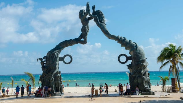 The monument to humanity, a bronze statue titled Portal Maya (Mayan Gateway), at the plaza in Playa del Carmen near Cancun in the state of Quintana Roo, Mexico, is a popular tourist attraction.