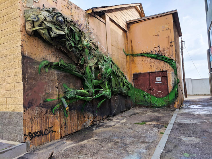 The neighborhood in San Nicolas is filled with unique art installations like this metal iguana by artist Bordalo II © Alicia Johnson / Lonely Planet