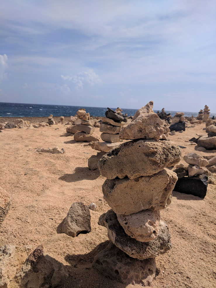 Once an Aruban fishing tradition, stacking rocks is something everyone can take part in © Alicia Johnson / Lonely Planet