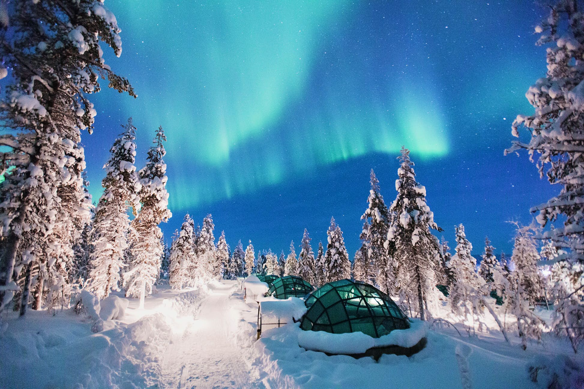 The magical Northern Lights put on a show over Finnish Lapland @ Courtesy of Kakslauttanen Arctic Resort