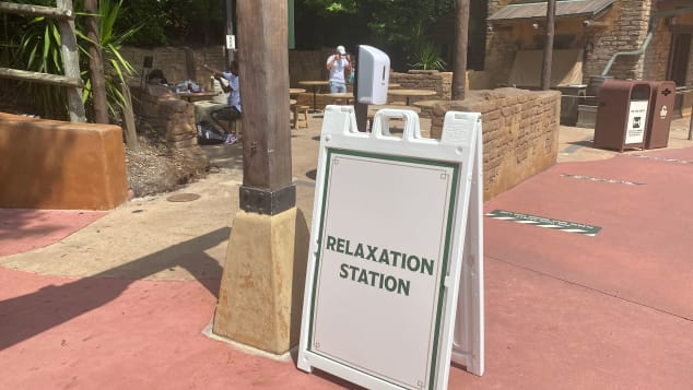 Parkgoers can take off their mask in designated Relaxation Stations. Julie Tremaine for CNN