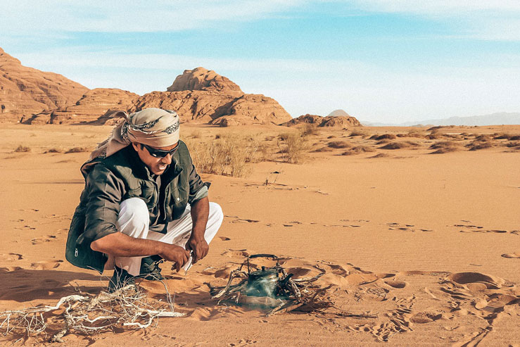 Ali starts a fire for tea © Geri Moore / Lonely Planet