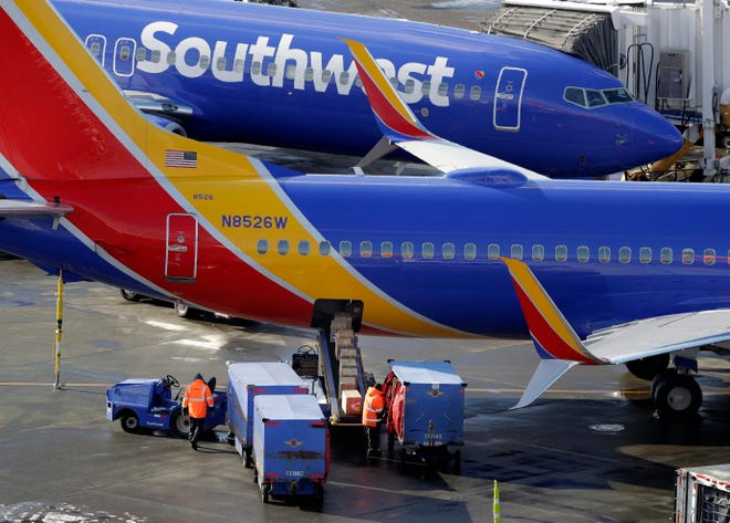 Southwest Airlines planes are loaded at Seattle-Tacoma International Airport on Feb. 5, 2019. Ted S. Warren, AP
