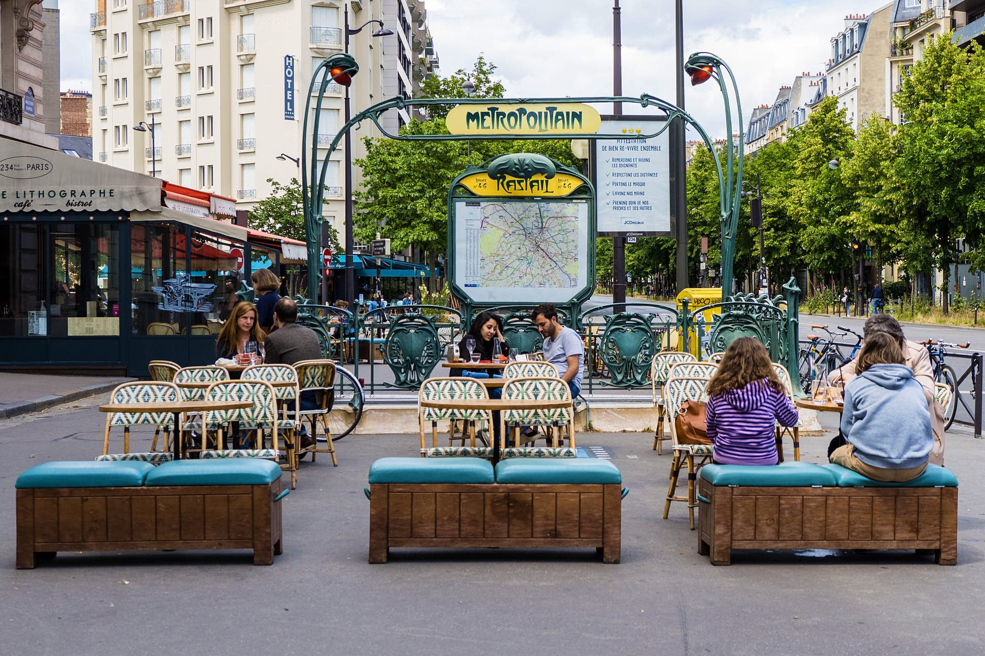 People sit at a terrace in front of the Raspail metro station in the 14th arrondissement of Paris, as bars and restaurants reopen after two months of nationwide restrictions ©Edward Berthelot/Getty Images