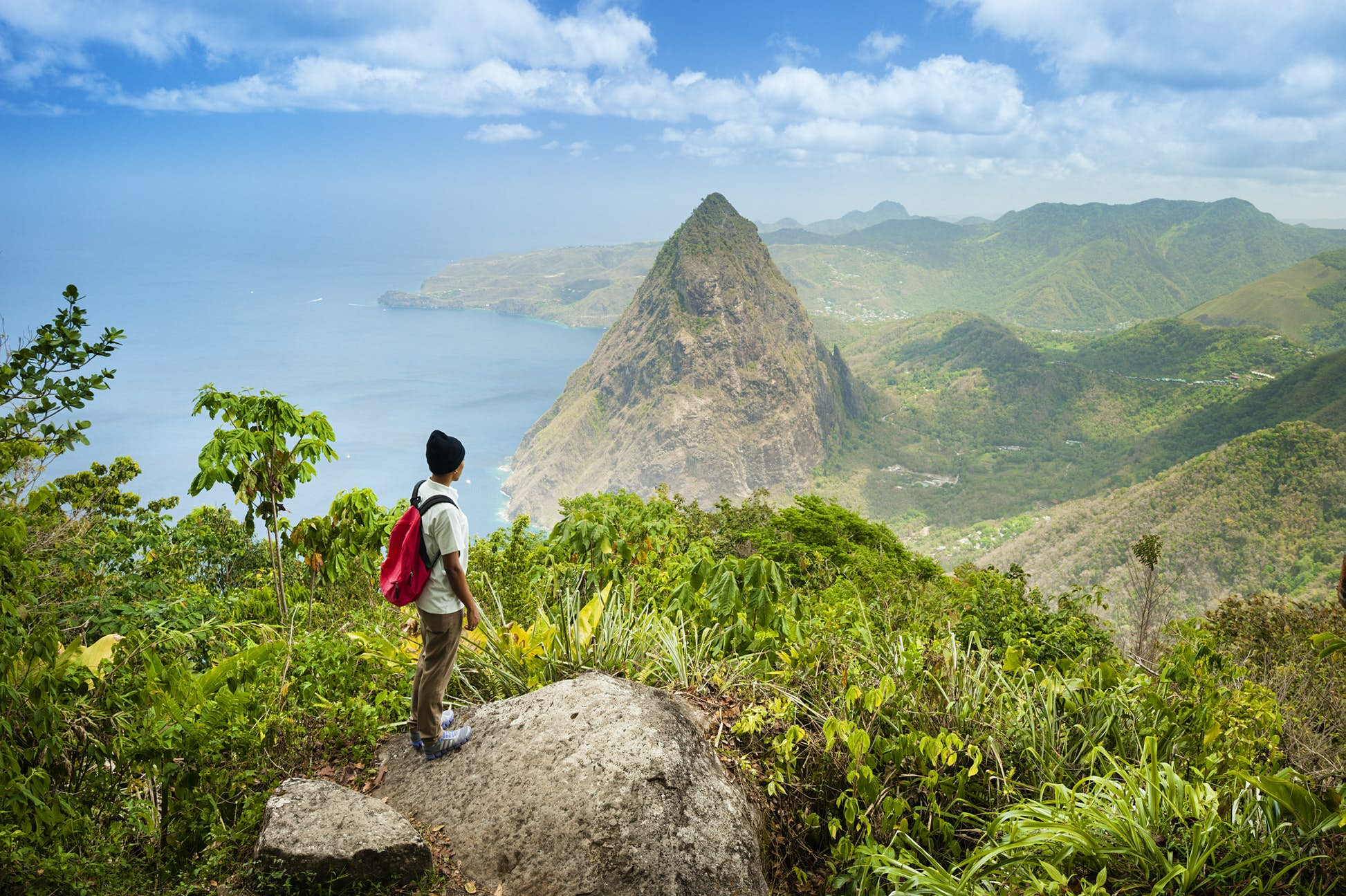 Hiker standing at lookout towards Gros Piton © Justin Foulkes / Lonely Planet