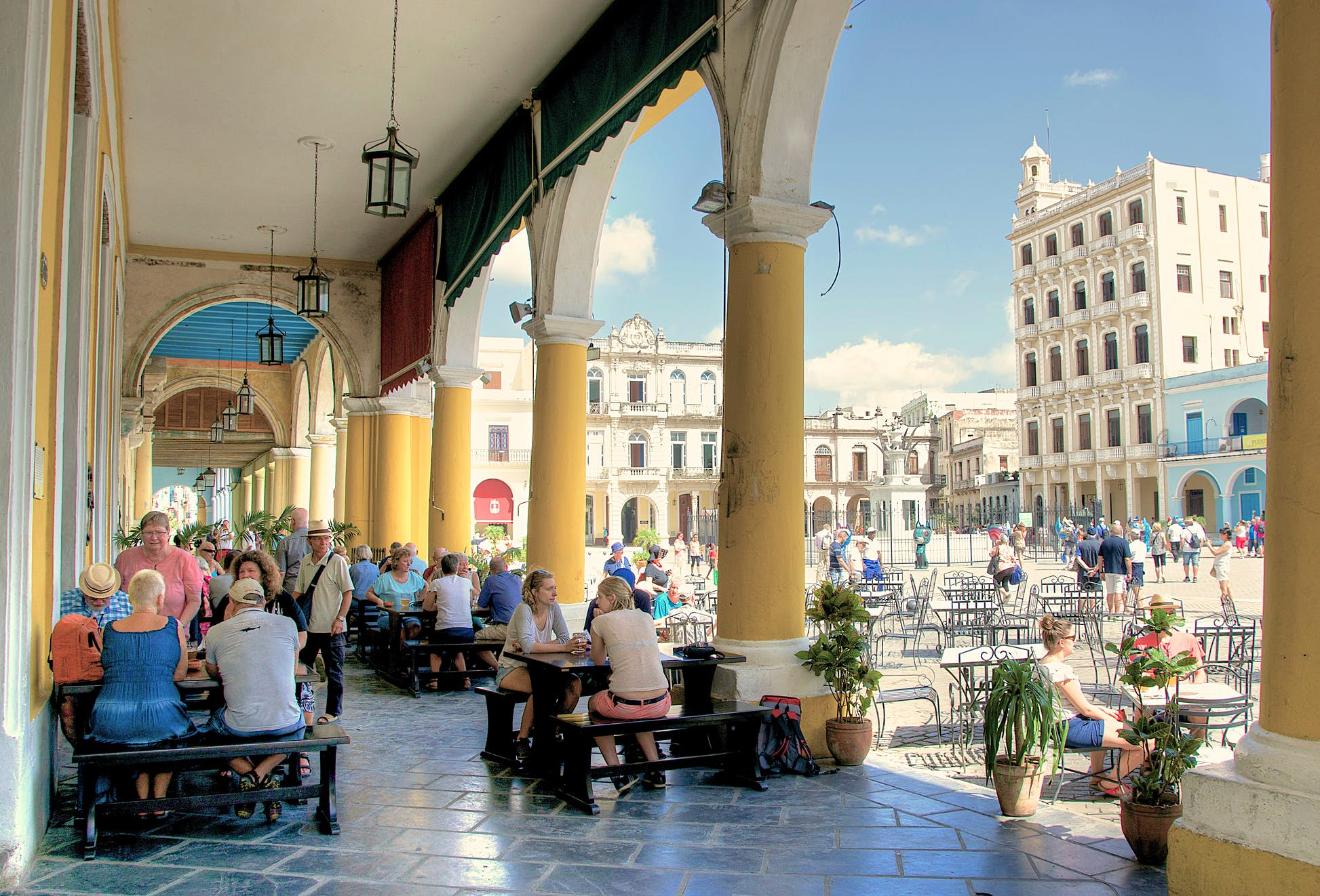 Visitors sitting at a cafe in Plaza Vieja (Old Square): tourism is the mainstay of the Cuban economy © Alarax/Shutterstock